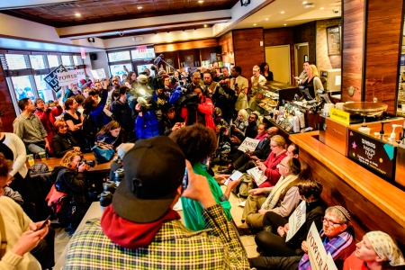 Philadelphia, USA. 16th Apr, 2018. Following the controversial arrests of two black men in a Starbucks outlet in Philadelphia, dozens of protesters again sat in demanding the multinational chain to take responsibility for racist practices and contributing
